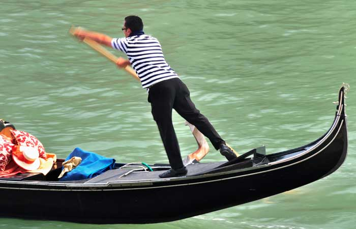 Balancing Act of A Venetian Gondolier